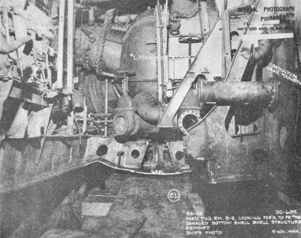 Photo 42: WADLEIGH (DD 689) Looking forward after removal of damaged bottom plating. Note centerline keel cut beyond plating.