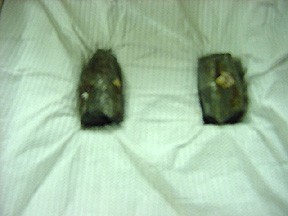 Fragments of the North Vietnamese machine gun bullet recovered from USS Maddox following the 2 August 1964 attack in the Gulf of Tonkin.