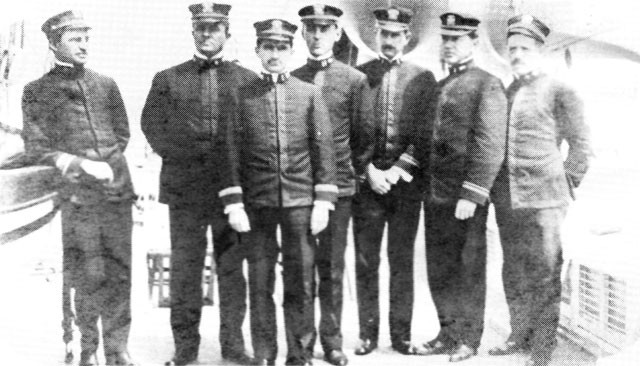 Image of Medical Officers of Hospital Ship Relief: (L to R) LCDR Arthur Dunbar, CAPT Charles Stokes, LT Walter Sharp (Paymaster), LT Howard P. Strine, LTJG Waiter F. Schaller, LTJG John Downey and LCDR Raymond Spear. Missing from the photo is LT George B. Trible.