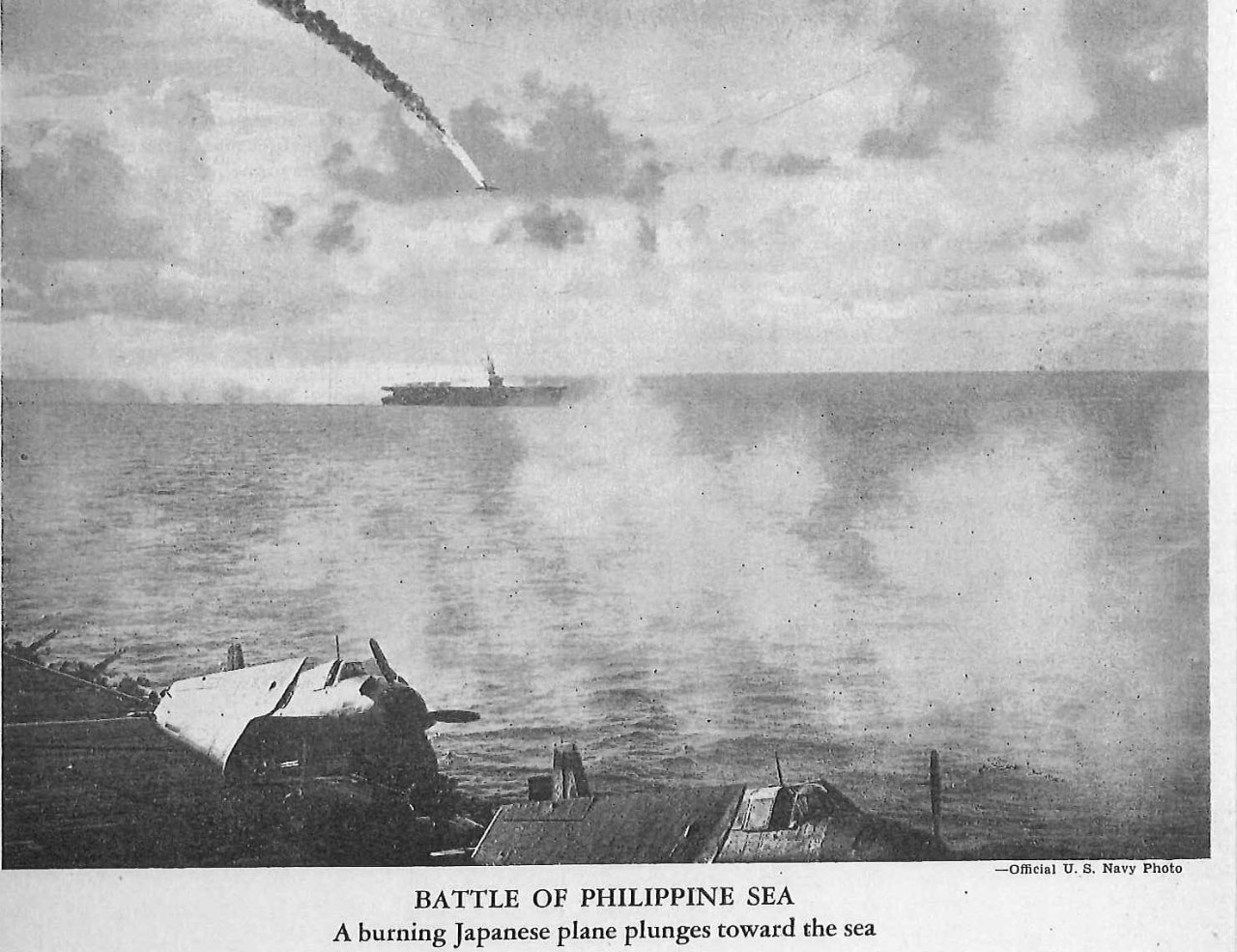 Battle of Philippine Sea, a burning Japanese plane plunges toward the sea