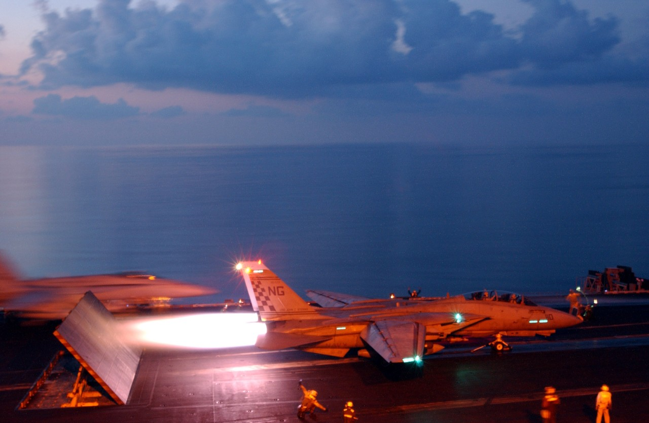 jpeg  of an F-14 Tomcat from Fighter Squadron 211 (VF-211) launching from the flight deck of John c. Stennis (CVN-74) to conduct missions in support of Operation Enduring Freedom