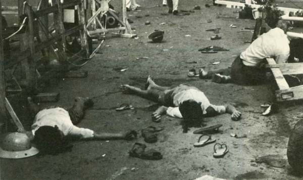 Image - Today Communist terrorism is taking its toll of South Viet-Nam's innocent people. The bodies of 2 boys and a man lie in the street following a Viet Cong grenade attack that killed 7 persons and wounded 47. The grenade was tossed into a helicopter on display at Saigon City Hall on Republic Day, Oct. 26, 1962.