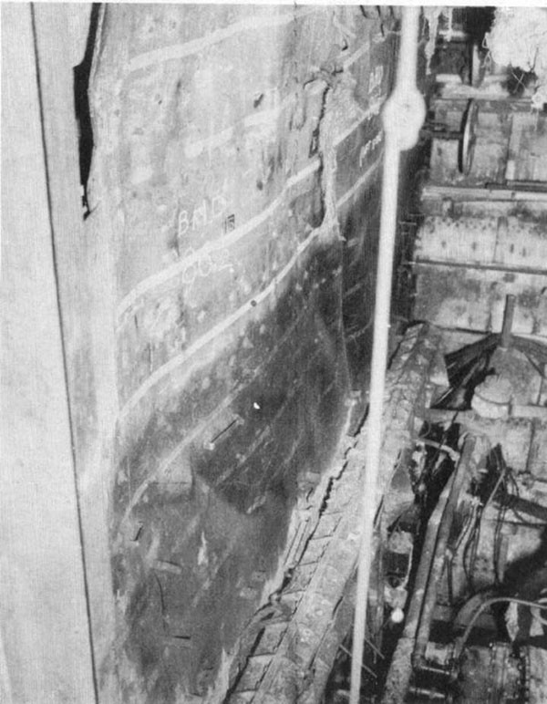 Photo 13: Damage to forward port side of bulkhead 86-1/2.