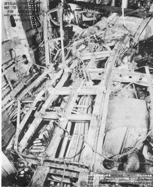 Photo 20: Interior view of forward engineroom, looking forward on port side, showing damage to main switchboard platform.