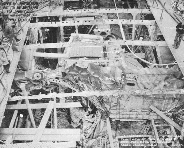 Photo 21: Plan view of forward engineroom and fireroom, showing damage to port shell and bulkhead 92-1/2.