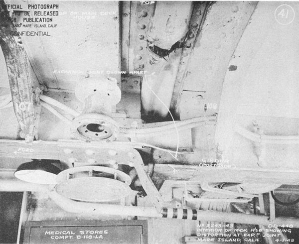 Photo 23: Interior view of midship deck house showing damage to expansion joint frame 108.