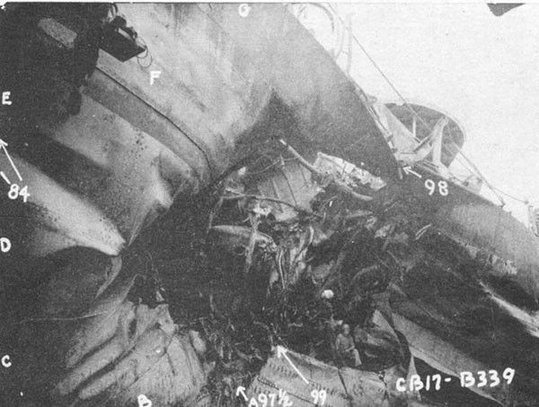 Photo 4: General view of torpedo damage looking aft. Sheer strake at frame 98 broke while docking.