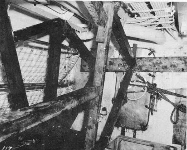 Photo 34: Compartment C-201-L showing shoring to bulkhead 157 performed by ABNER READ's repair parties.
