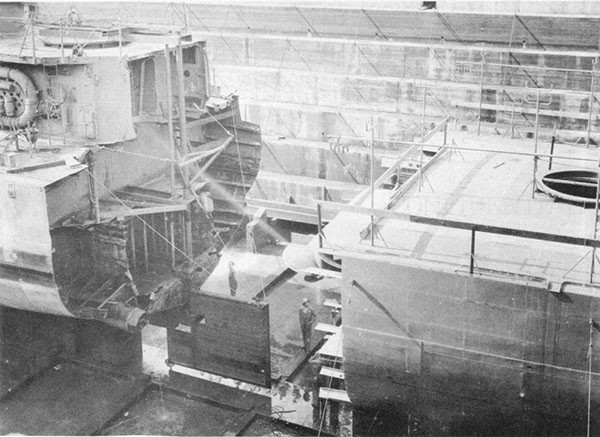 Photo 38: 7 October 1943 - ABNER READ in dry dock at Puget Sound Navy Yard showing temporary steering gear. Prefabricated stern section is in foreground.