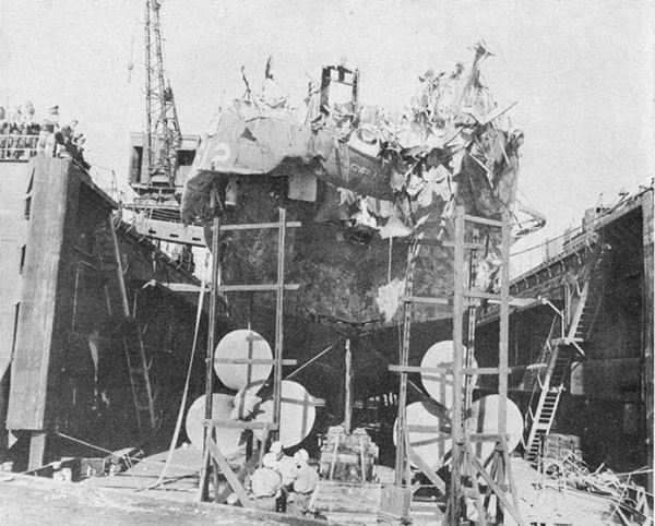 Photo 40: General view of damage to stern of USS KENDRICK while in dry dock Oran.
