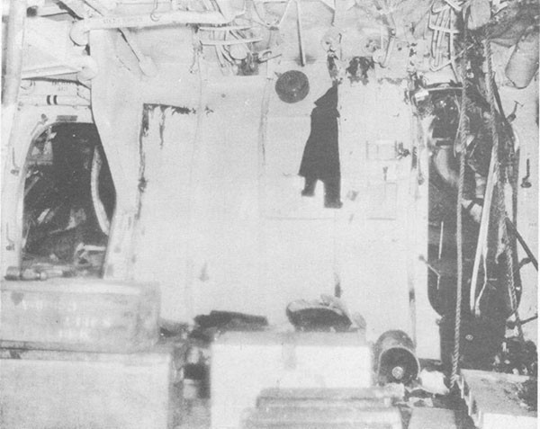 Photo 43: After bulkhead of crews' quarters C-204-L showing deflection of bulkhead.