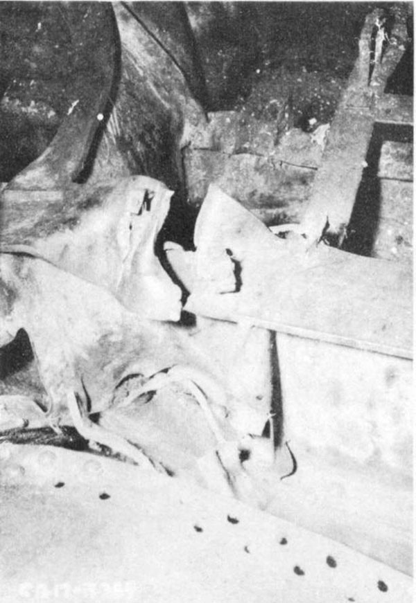 Photo 6: View of keel between frames 97 and 98 showing damage to flat keel, fracture of top flange and distortion and partial failure of vertical keel.