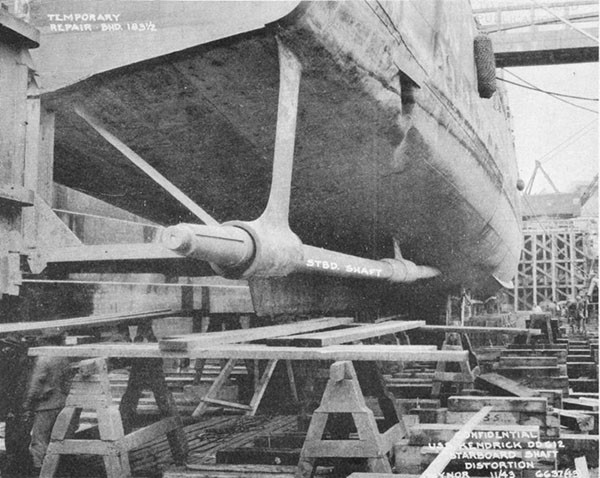 Photo 47: Starboard view of stern showing details of temporary rudder connections to hull.