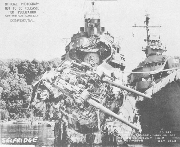 Photo 49: Bow view of torpedo damage to USS SELFRIDGE while alongside O'BANNON in Tulagi Harbor.