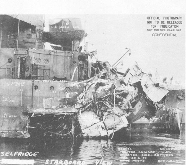 Photo 50: Starboard side view of torpedo damage to SELFRIDGE.