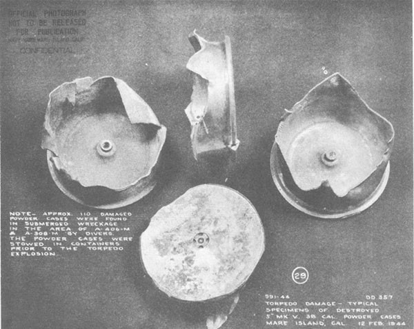 Photo 55: Typical specimens of damaged Mark V, 5-inch 38 caliber powder cases found in A-406-M and A-308-M.