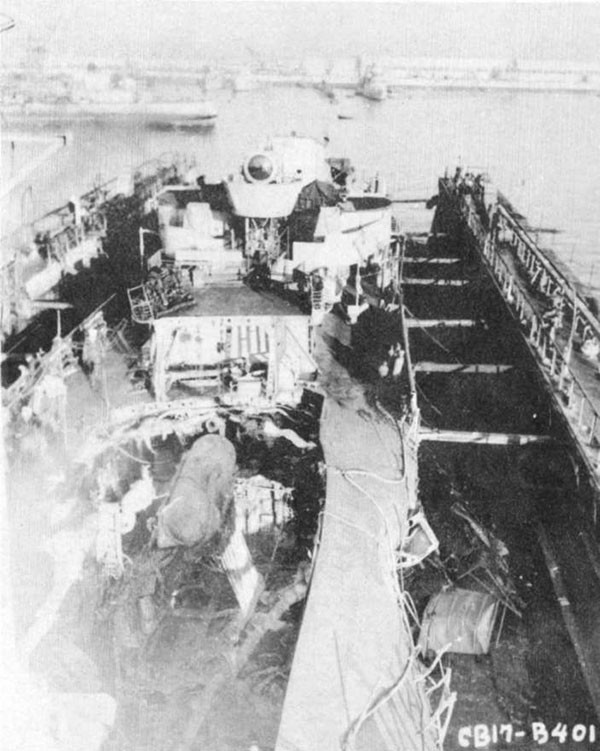 Photo 8: 9 February 1943 - General view of damage to forward engineroom, after fireroom and main deck after removal of No. 2 smokepipe and deck house.