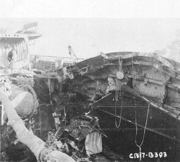 Photo 10: 9 February 1943 - View of damage to port-side main deck structure looking aft and to port.