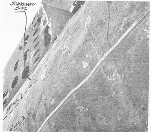 Photo 6-2: TUNNY (SS282). Close view, looking up, showing depressions in pressure hull plating between frames, starboard side.