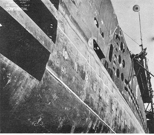 Photo 6-4; TUNNY (SS282). General view of port side, forward, showing deformation in way of single hull and forward trim tank.