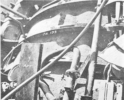 Photo 7-2: SALMON (SS182). General view, looking aft, showing deformation in pressure hull plating between tank tops over the after engine room, frames 129-137.