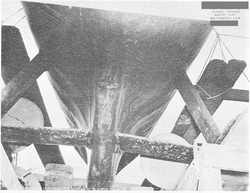 Photo 7-5: SALMON (SS182). View showing depressions in shell plating between frames in after trim tank, believed due to over-depth failure.