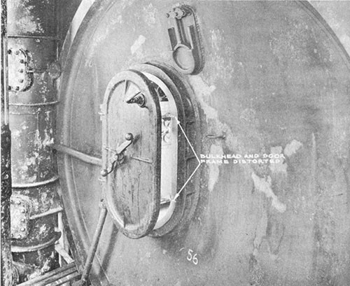 Photo 5-5: KINGFISH (SS234). View showing conning tower after bulkhead, indicating points at which W.T. door dogs bound due to distortion of bulkhead and door seat.