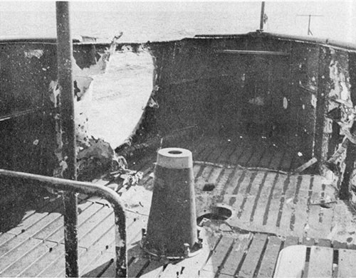 Photo 12-1: GRAMPUS (SS207). Projectile entry hole in starboard bulwark of cigarette deck.