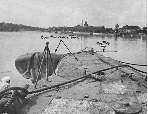 Photo 13-1: GROWLER (SS215). General view looking forward at collision damage to bow. Section forward of frame 4 is bent 90 degrees to port.