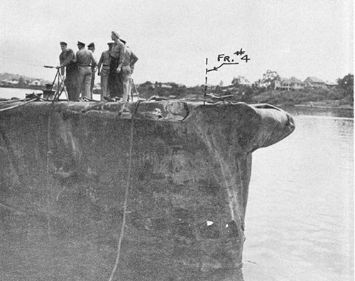 Photo 13-2: GROWLER (SS215). General view from starboard forward showing collision damage to bow.