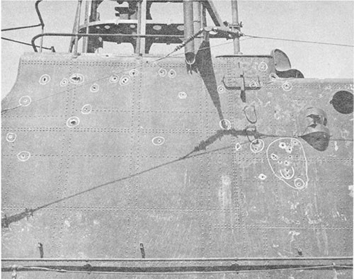Photo 13-4: GROWLER (SS215). 13mm machine gun projectile holes, bridge and conning tower fairwater, starboard side.