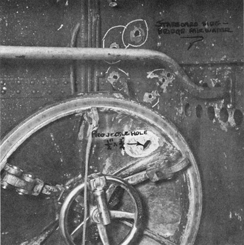 "Photo 13-5: GROWLER (SS215). View of conning tower upper hatch, showing 13mm projectile hole (1/2"" x 3/4"")."