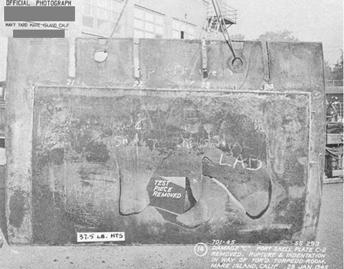 "Photo 14-4: DRAGONET (SS293). View showing close detail of damage ""C"" to port pressures hull plating (37.5 pound HTS) of forward torpedo room. Small section of plate has been removed for test."