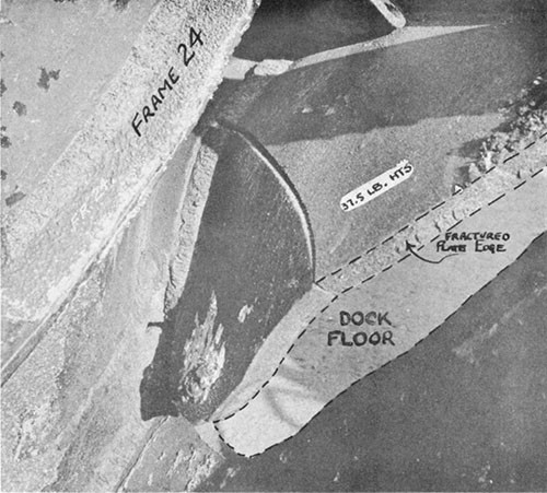 "Photo 14-5: DRAGONET (SS293). View taken from interior of forward torpedo room looking down and to port, showing close detail of typical fracture in pressure hull plating (37.5 pound HTS) at damage ""C""."