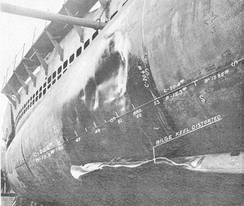 "Photo 14-6: DRAGONET (SS293). View showing damage ""D"" in way MBT Nos. 2B and 2D. Although considerably deformed, the outer shell plating above the bilge keel was not ruptured."