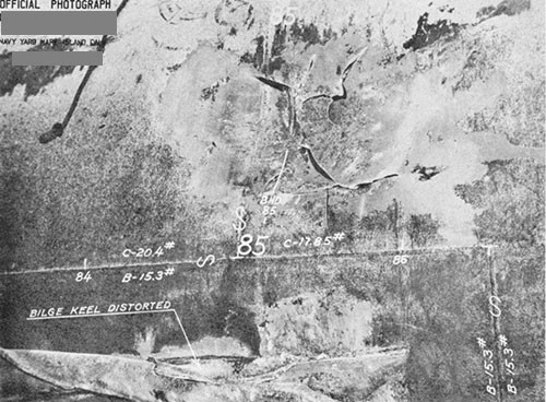 "Photo 14-8: DRAGONET (SS293). View of damage ""E"" showing rupture and deformation of outer shell plating of MBT Nos. 6B and 6D at wing bulkhead 85 dividing the two tanks."