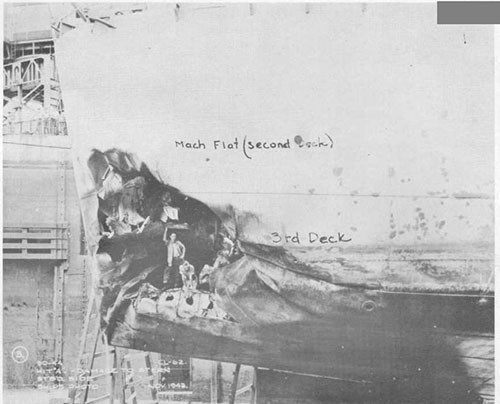 Photo 1: Bomb damage to stern, starboard side.