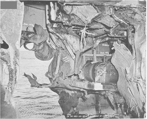 Photo 2: Bomb damage to stern. Starboard side looking aft and to port.