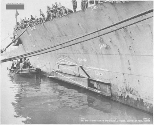 Photo 14: Torpedo damage, port side, showing temporary patch.