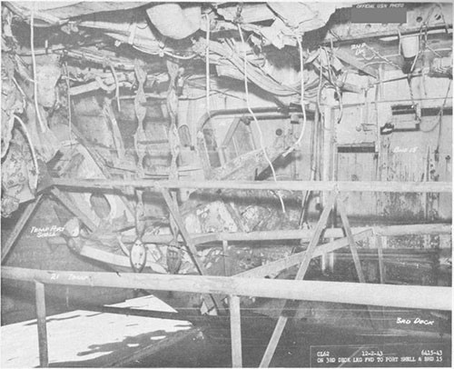 Photo 15: Torpedo damage, third deck level. Looking forward to port showing temporary pipe stringers.