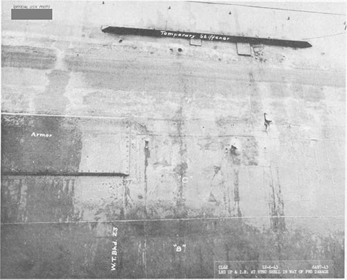 Photo 16: Torpedo damage, starboard side, snowing fragment holes in shell.