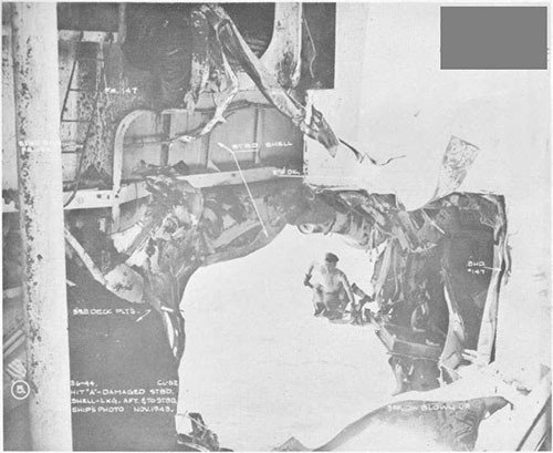 Photo 3: Bomb damage to stern. Looking aft and to starboard.
