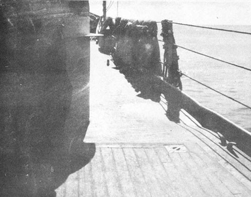 Photo 13: Starboard side forecastle, looking forward showing buckled deck.