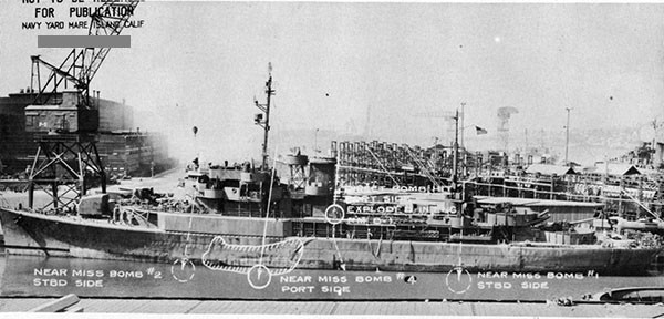 Photo 1: View of port side, showing locations of bombs.