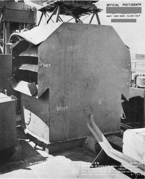 Photo 11: Blast damage to ventilation cowl on superstructure deck.