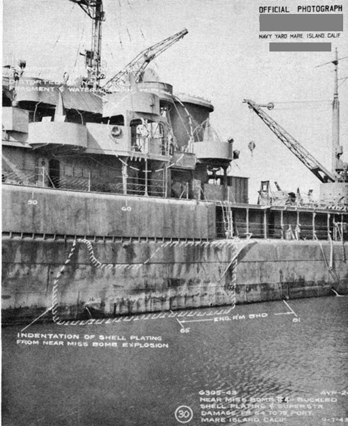 Photo 13: Damage to shell from bomb No. 4. Note damage to superstructure from water geyser.