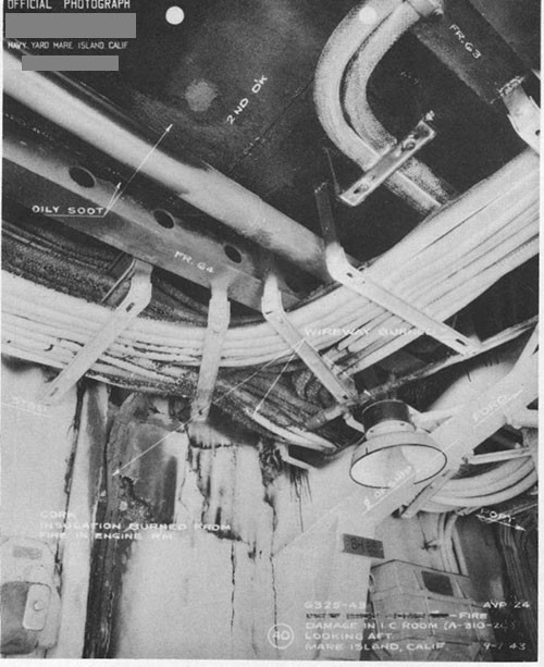 Photo 17: Fire damage in I.C. room (A-310-2C) looking aft.
