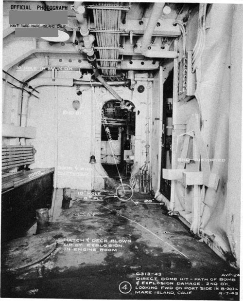 Photo 6: Path of direct hit bomb No. 3 through main and second decks. Note buckled deck and bulkheads due to detonation in engine room below.