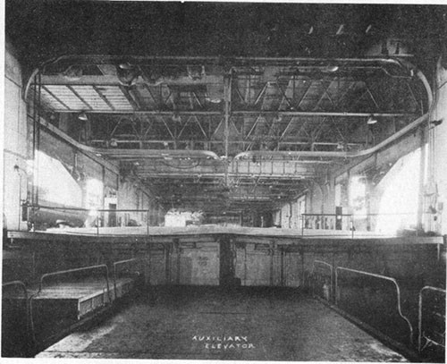 Photo E-10: First hit. View forward across No. 3 elevator pit showing bulge in main deck.