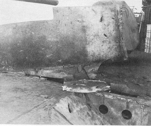 Photo E-14: Second hit. Damage to STS shield between Nos. 5 and 7 guns.